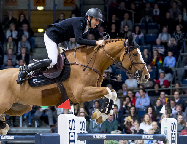 Belgium's Pieter Devos jumps on top of the World Cup ranking